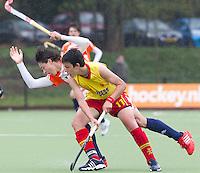 AERDENHOUT - 09-04-2012 - Jasper Luykx wordt weggezet door Lucas Carcia Alcaida maandag tijdens de finale tussen Nederland Jongens B en Spanje Jongens B  (3-1) , tijdens het Volvo 4-Nations Tournament op de velden van Rood-Wit in Aerdenhout. Jongens U16 wordt kampioen.FOTO KOEN SUYK