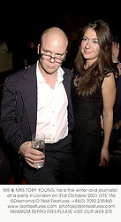 MR & MRS TOBY YOUNG, he is the writer and journalist, at a party in London on 31st October 2001.	OTS 156