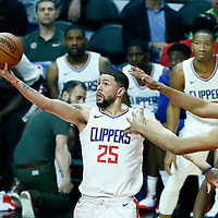 06 December 2017: LA Clippers guard Austin Rivers (25) goes for the layup past Minnesota Timberwolves center Karl-Anthony Towns (32) during the Minnesota Timberwolves 113-107 victory over the LA Clippers, at the Staples Center, Los Angeles, California, USA.