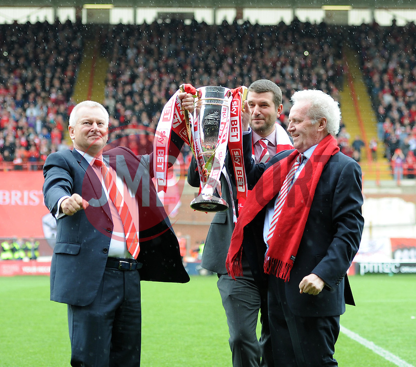 Steve Lansdown, Jon Lansdown and Keith Dawe parade with the Sky Bet League One Trophy - Photo mandatory by-line: Paul Knight/JMP - Mobile: 07966 386802 - 03/05/2015 - SPORT - Football - Bristol - Ashton Gate Stadium - Bristol City v Walsall - Sky Bet League One