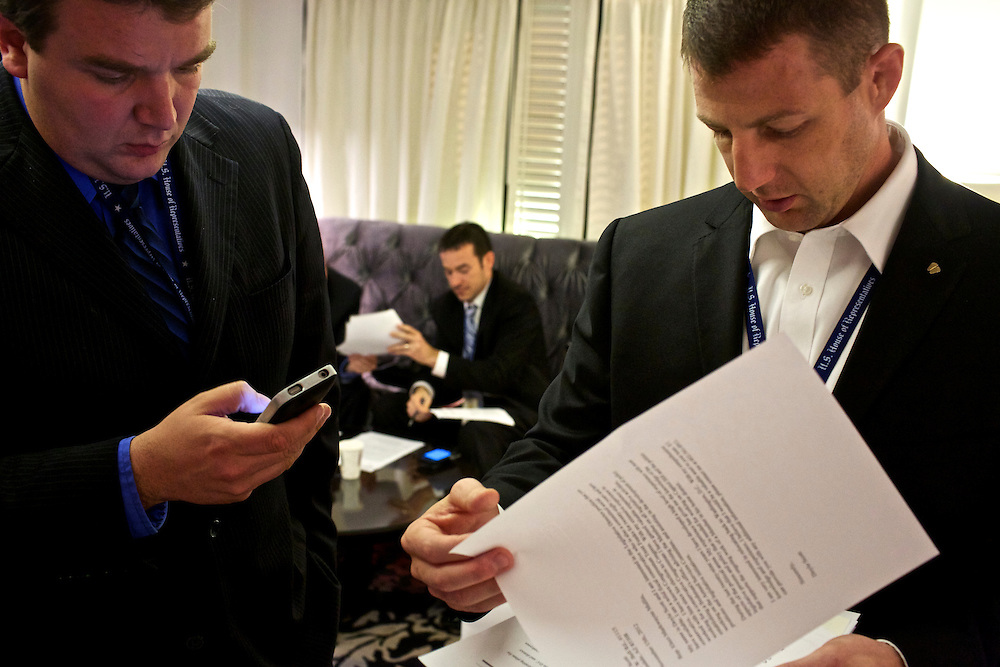 Congressman-elect Markwayne Mullin, from Oklahoma's 2nd District, right, looks over resumes with staff member Tim Ross, left, in the lobby of the Capitol Hill Hotel in Washington, DC on Nov. 29, 2012. Into his second week of orientation, Congressman-elect Mullin is deciding everything from who will be on his staff to what office furniture he will have.