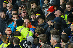 A Watford fan is escorted from the ground by stewards and police - Mandatory by-line: Jason Brown/JMP - 21/01/2017 - FOOTBALL - Vitality Stadium - Bournemouth, England - Bournemouth v Watford - Premier League