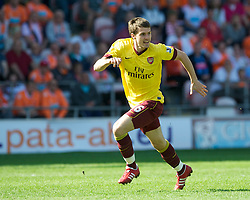 BLACKPOOL, ENGLAND - Sunday, April 10, 2011: Arsenal's Aaron Ramsey in action against Blackpool during the Premiership match at Bloomfield Road. (Photo by David Rawcliffe/Propaganda)