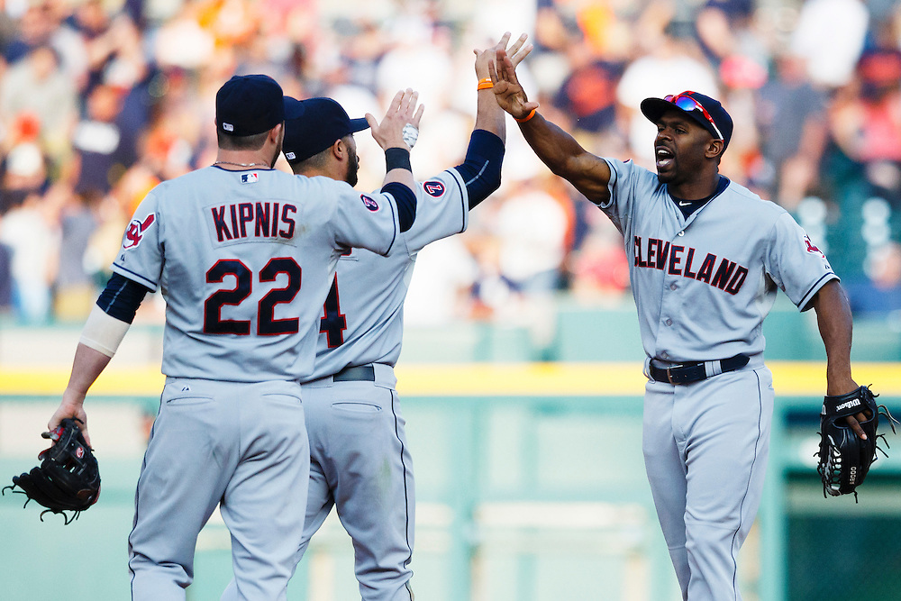 Jun 13, 2015; Detroit, MI, USA; Cleveland Indians second baseman Jason Kipnis (22) shortstop Mike Aviles (4) and center fielder Michael Bourn (24) celebrate after the game against the Detroit Tigers at Comerica Park. Cleveland won 5-4. Mandatory Credit: Rick Osentoski-USA TODAY Sports