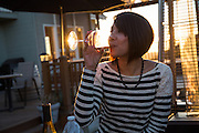 Melissa Rodriguez of San Jose enjoys wine with friends during sunset at Big Dog Vineyards in Milpitas, California, on January 5, 2014. Big Dog Vineyards is open for wine tasting the first full weekend of each month and is located at 4545 Felter Rd. (Stan Olszewski/SOSKIphoto)