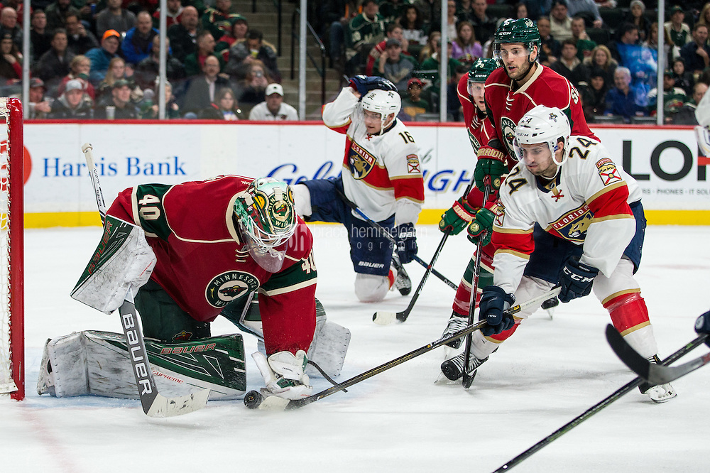 Dec 13, 2016; Saint Paul, MN, USA; Minnesota Wild goalie Devan Dubnyk (40) makes a save in front of Florida Panthers forward Seth Griffith (24) during the first period at Xcel Energy Center. Mandatory Credit: Brace Hemmelgarn-USA TODAY Sports