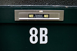 8B, the house number marked on the front door of my old home. The sticker on the letter slot indicates the residents prefer no spam.<br /> <br /> After living abroad for more than three years I visited my old home town. Wondering what has changed I packed both my curiosity and a camera. (Original posted as part of a photo essay 'Revisiting Familiar Grounds' here: http://www.basslabbers.com/WP/?p=1320)
