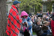 Family and friends bundle up at the University of Rochester's Commencement ceremony in Rochester on Sunday, May 15, 2016.