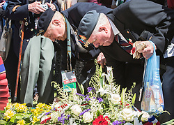 © Licensed to London News Pictures. 06/06/2014. Bayeux, Normandy.  Veterans and their guests attended a memorial service at the British military cemetery in Bayeux during the 70th Anniversary D Day commemorations.  Also in attendance were HRH The Queen and Prince Phillip and various British political figures.  Photo credit : Alison Baskerville/LNP