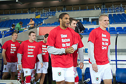 CARDIFF, WALES - Friday, October 8, 2010: Wales' captain Ashley Williams wearing a 'Show Racism the Red Card' t-shirt before the UEFA Euro 2012 Qualifying Group G match against Bulgaria at the Cardiff City Stadium. (Pic by David Rawcliffe/Propaganda)