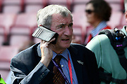 David Pleat on the phone during the Premier League match between Bournemouth and Manchester City at the Vitality Stadium, Bournemouth, England on 26 August 2017. Photo by Graham Hunt.