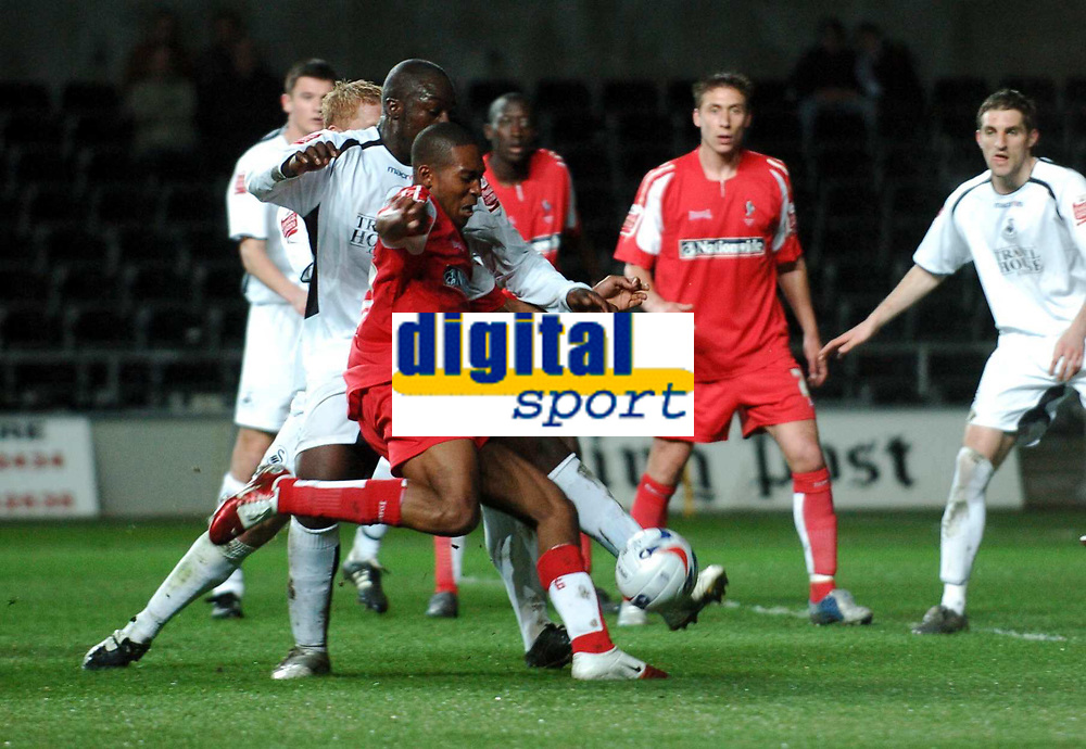 Photo: Adam Davies.<br /> Swansea City v Swindon Town. Coca Cola League 1. 11/04/2006.<br /> Swindon's Ricky Shakes beats Swansea's Adebayo Akinfenwa to score Swindon's only goal.