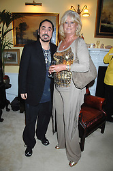 DAVID GEST and MARILYN GALSWORTHY at a party to celebrate the 21st birthday of one of their horses Leopold, held at 35 Sloane Gardens, London W1 on 10th September 2007.<br />