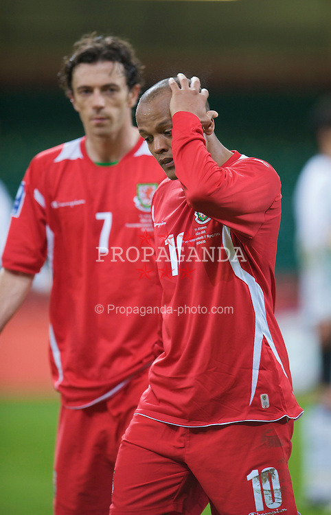 CARDIFF, WALES - Wednesday, April 1, 2009: Wales' emotional Robert Earnshaw' walks off dejected with captain Simon Davies after his side's 2-0 defeat by Germany during the 2010 FIFA World Cup Qualifying Group 4 match at the Millennium Stadium. (Pic by David Rawcliffe/Propaganda)