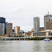 Brisbane River and city skyline as seen from Southbank with the distinctive Southeast Freeway running along the waterfront