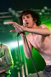 © Licensed to London News Pictures. 22/08/2014. Reading, UK.   Fat White Family performing live at Reading Festival 2014 on Friday, the opening day.     In this picture - Lias Saudi .  Photo credit : Richard Isaac/LNP
