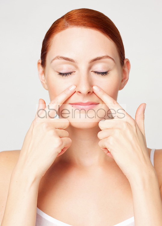 Woman with Fingertips on Side of the Nose