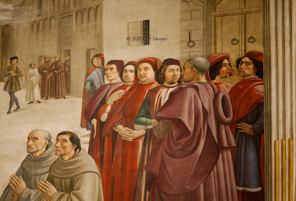 Sassetti chapel in Santa Trinita with frescoes by Domenico Ghirlandaio of the Life of St. Francis, 1483-86.  Group of well dressed men seem to be talking; two kneeling friars in their robes..  Self-portrait at the far right, looks out towards us.