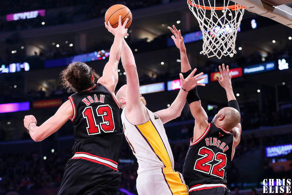 09 February 2014: Los Angeles Lakers center Chris Kaman (9) is blocked by Chicago Bulls center Joakim Noah (13) during the Chicago Bulls 92-86 victory over the Los Angeles Lakers at the Staples Center, Los Angeles, California, USA.