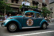 June 18, 2011, Boston, MA - A fan drives his Bruins Volkswagen Beatle down Boylston Street buring the morning hours before police closed the street for the parade route. Photo by Lathan Goumas.