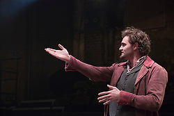 """© Licensed to London News Pictures. 21/11/2013. London, England. Pictured: Tom Bateman as Dante Gabriel Rosetti. World premiere of the play """"Lizzie Siddal"""" at the Arcola Theatre, Hackney, London. The play tells the story of the woman who was 'Ophelia' in Millais' famous painting. Running from 20 November to 21 December 2013. With Emma West as Lizzie Siddal and Tom Bateman as Dante Gabriel Rossetti. Photo credit: Bettina Strenske/LNP"""