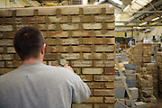 A prisoner learns building skills in the workshop. HMP Wandsworth, London, United Kingdom