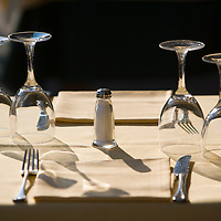 Salt shaker and glasses on restaurant table, outdoors, Portofino, Ligury, Italy