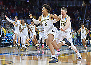 Michigan Wolverines guard Jordan Poole (2) celebrates with his teammates including Moritz Wagner (13) after making the game-winning three point shot to defeat the Houston Cougars in the second round of the 2018 NCAA Tournament at INTRUST Bank Arena.
