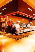 Michihiro Kigawa at the counter and open kitchen at Kigawa restaurant.