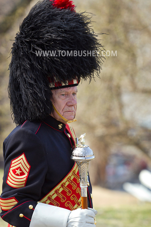 West Point, New York - A drum major from the Leatherneck Pipes and Drums gets ready to perform at the 32nd annual West Point Military Tattoo at Trophy Point at the United States Military Academy on April 13, 2014.