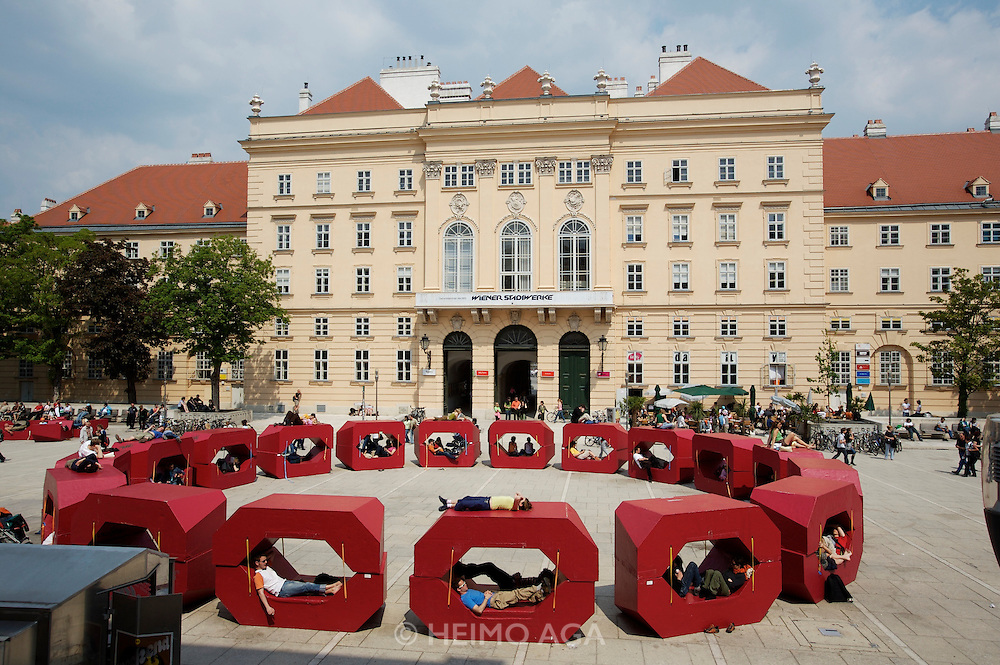 During the summer months, visitors of Museumsquartier Vienna can relax on comfortable plastic sofas, this year painted in burgundy red.