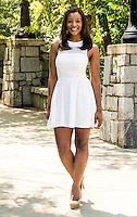 Full Body portrait of a woman in a white dress standing in a park