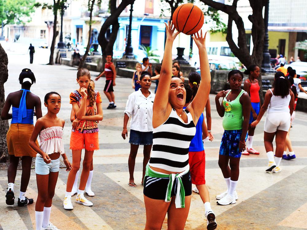 Cuban school children play basketball in  the streets of Havana, Cuba.