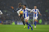 Football - 2018 / 2019 Premier League - Brighton and Hove Albion vs. Leicester City<br /> <br /> Wilfred Ndidi of Leicester City goes shoulder to shoulder with Beram Kayal of Brighton during the Premier League match at The Amex Stadium Brighton   <br /> <br /> COLORSPORT/SHAUN BOGGUST