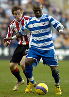 Photo: Gareth Davies.<br />Reading v Sheffield United. The Barclays Premiership. 20/01/2007.<br />Leroy Lita (R) holds the ball off Sheffield United's Rob Kozluk (L).