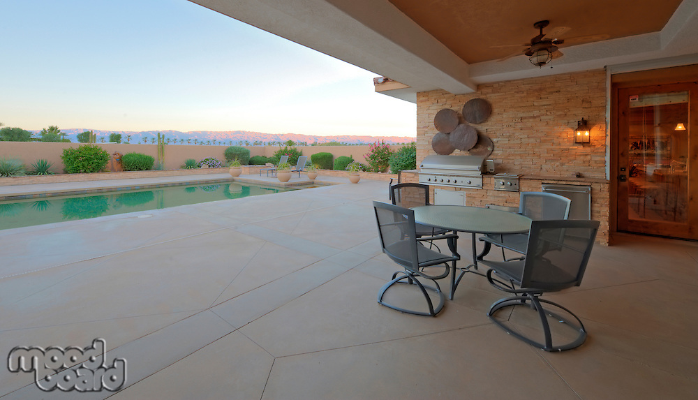 Patio and barbecue area with view to pool