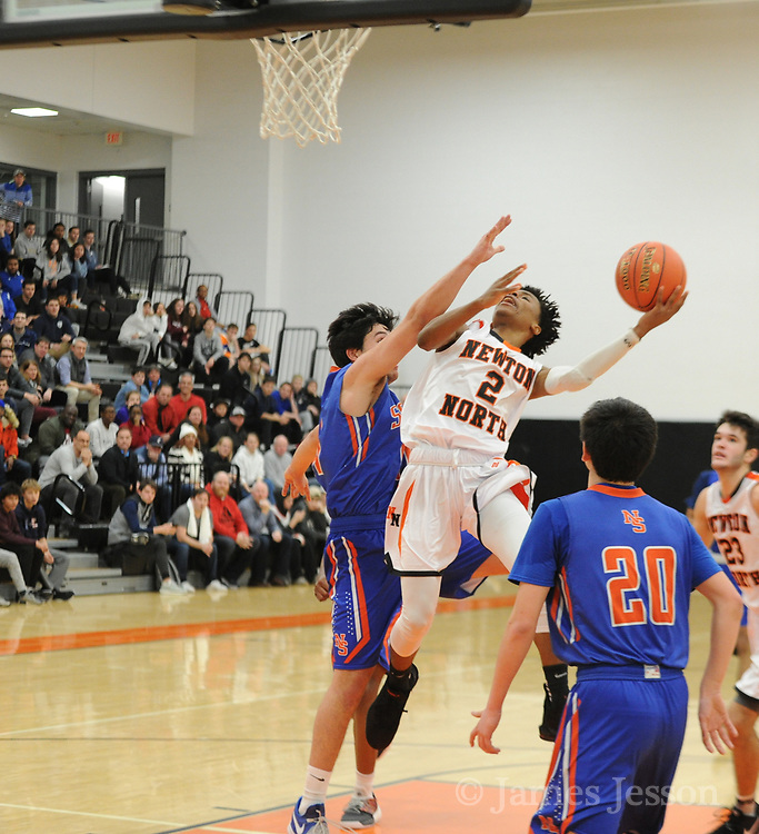 Newton North junior Tyson Duncan goes up to the basket during the game against Newton South at Newton North, Dec. 27, 2018.   [Wicked Local Photo/James Jesson]