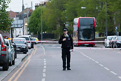 © Licensed to London News Pictures. 05/05/2019. London, UK.  Police at the scene in High Road Leytonstone this evening. Police were called at 00:40hrs today, 5th May following reports of a car in collision with two pedestrians on High Road Leytonstone. Two men were taken to hospital by London Ambulance Service and one of the men has died. Photo credit: Vickie Flores/LNP