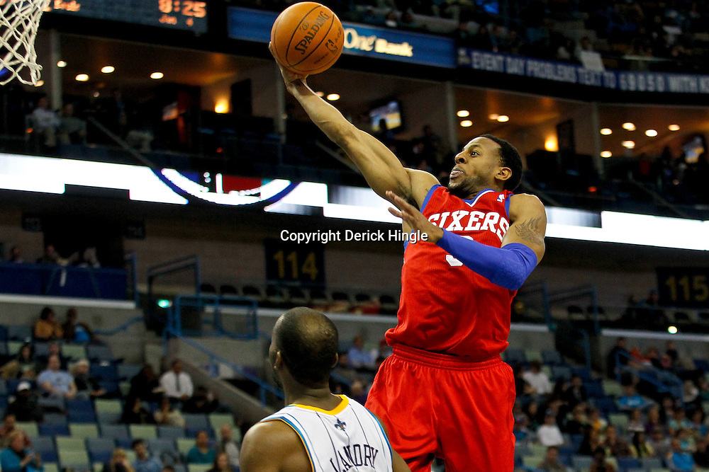 January 4, 2012; New Orleans, LA, USA; Philadelphia 76ers small forward Andre Iguodala (9) shoots over New Orleans Hornets power forward Carl Landry (24) during the second half of a game at the New Orleans Arena. The 76ers defeated the Hornets 101-93.  Mandatory Credit: Derick E. Hingle-US PRESSWIRE