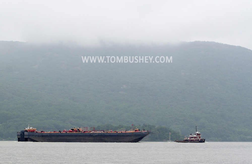 New Windsor, New York - A tugboat pulls the tanker barge RTC 120 down the Hudson River on June 13, 2010. The barge is 405 feet long.
