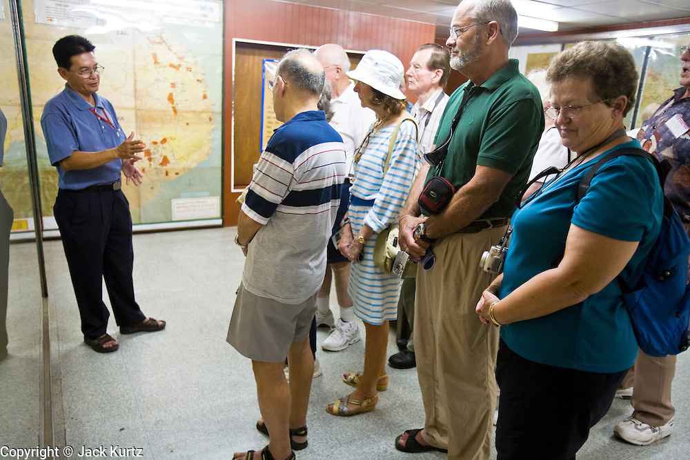 09 MARCH 2006 - HO CHI MINH CITY, VIETNAM: A Vietnamese tour guide talks to American tourists about the bomb shelter/bunker complex used by South Vietnamese President Theu during the Vietnam War in what was then called the Presidential Palace in Saigon. The complex, which was the heart of the South Vietnamese government, is now called Reunification Hall and is preserved as a museum in the center of Ho Chi Minh City. Photo by Jack Kurtz