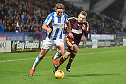 Huddersfield Town defender Michael Hefele (44) and Freddie Sears (20) Ipswich Town during the EFL Sky Bet Championship match between Huddersfield Town and Ipswich Town at the John Smiths Stadium, Huddersfield, England on 21 January 2017. Photo by Ian Lyall.