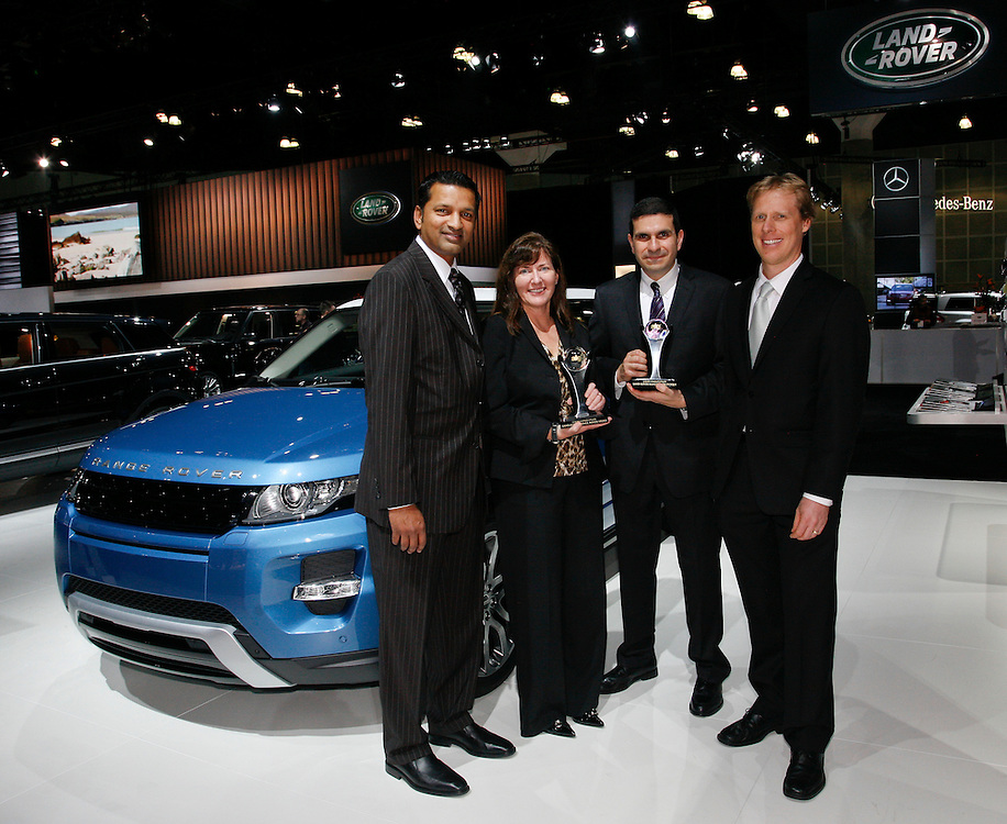 Left to right: Raj Sundaram, SVP DealerTrack; Kim McCullough, Brand Vice President, Land Rover North America; Andrew Polsinelli, General Manager Product Planning, Land Rover North America and Oliver Strauss, VP Analytics, Consulting and Editorial, ALG, at the Los Angeles Auto Show on November, 16, 2011. McCullough accepted the ALG Best Luxury Mid-sized Utility Vehicle Award for the 2012 Range Rover Sport and Polsinelli accepted the ALG Best Luxury Compact Utility Vehicle Award for the 2012 Range Rover Evoque.