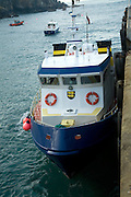 Ferry at quayside Maseline harbour, Island of Sark, Channel Islands, Great Britain