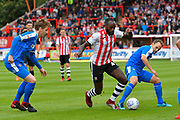 Hiram Boateng (44) of Exeter City battles for possession with David Vaughan (8) of Notts County during the EFL Sky Bet League 2 match between Exeter City and Notts County at St James' Park, Exeter, England on 8 September 2018.