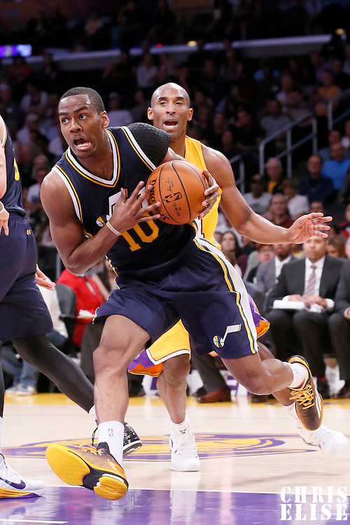 19 October 2014: Utah Jazz guard Alec Burks (10) drives past Los Angeles Lakers guard Kobe Bryant (24) during the Los Angeles Lakers 98-91 victory over the Utah Jazz, in a preseason game, at the Staples Center, Los Angeles, California, USA.