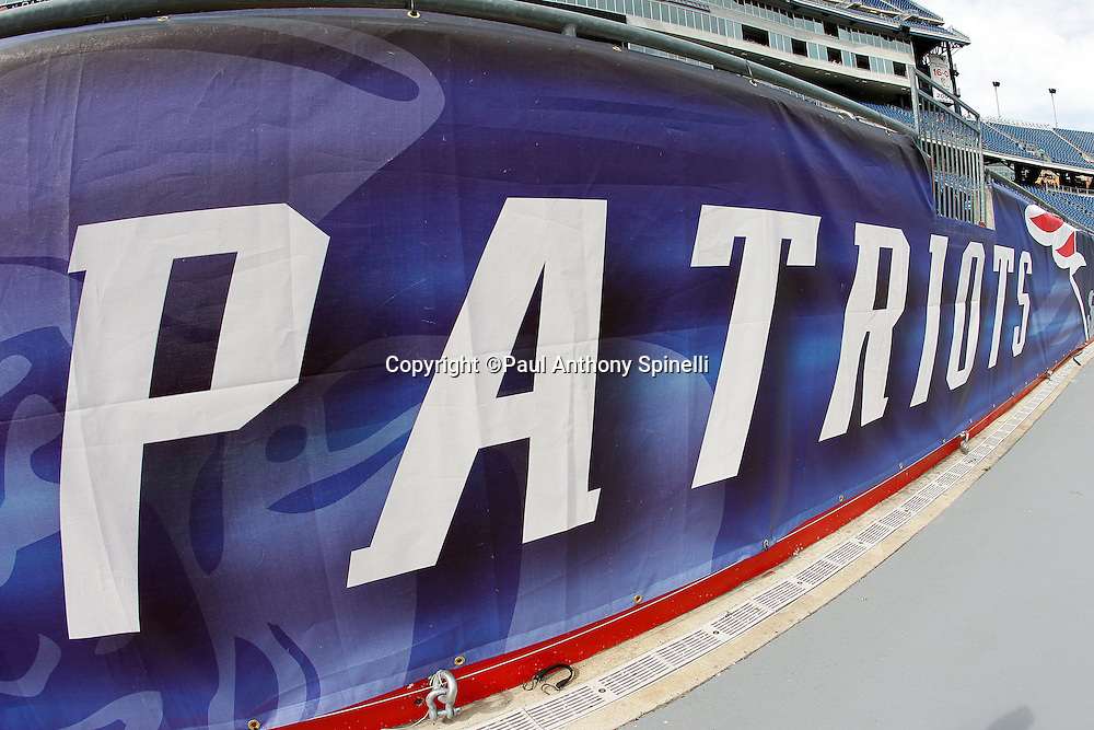 A Patriots banner lines the sideline wall at the New England Patriots NFL regular season week 3 football game against the Buffalo Bills on September 26, 2010 in Foxborough, Massachusetts. The Patriots won the game 38-30. (©Paul Anthony Spinelli)