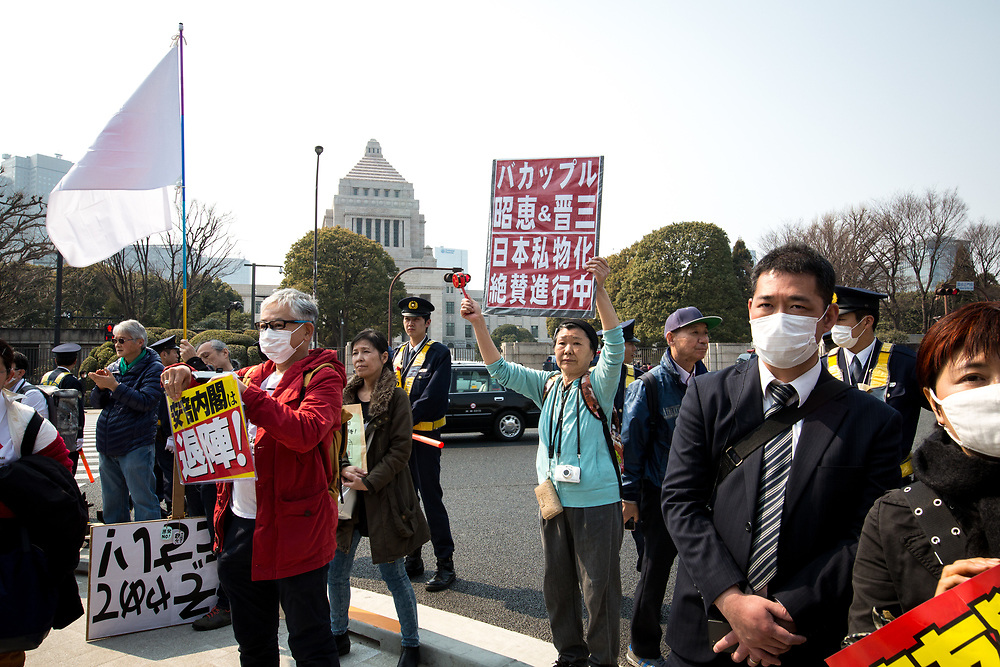 TOKYO, JAPAN - MARCH 19 : Anti-Shinzo Abe protesters holds a placards in front of Tokyo parliament during a rally, denouncing his government policies and calling on the Japanese prime minister to resign, Tokyo, Japan, March 19, 2017.  (Photo: Richard Atrero de Guzman/NUR Photo)