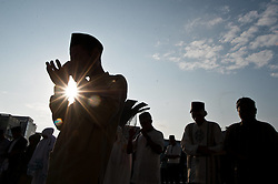 Image ©Licensed to i-Images Picture Agency. 28/07/2014. South Sumatera Province. Indonesia. <br /> 61981795<br /> Silhouette of muslims gather on the main way in front of the Great Mosque Palembang to attend the Eid Al-Fitr celebration in Palembang, South Sumatera Province in Indonesia, on July 28, 2014. Eid Al-Fitr marks the end of the Muslim fasting month of Ramadan. Picture by  imago / i-Images<br /> UK ONLY
