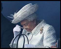 Image licensed to i-Images Picture Agency. 23/07/2014. Glasgow, United Kingdom. The Queen adjusts her glasses  at the start of opening  ceremony of the Commonwealth Games in Glasgow. Picture by Stephen Lock / i-Images